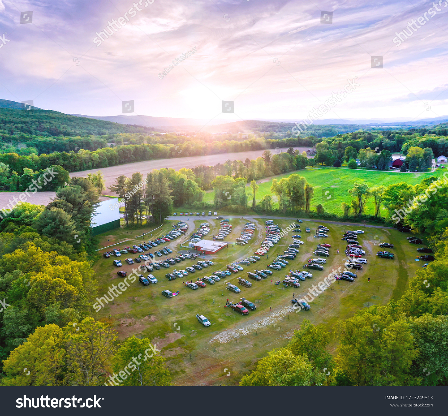 Aerial photo of beautiful outdoor country drive-in movie theater at sunset. Taken at Northfield Drive-In Theater. #1723249813