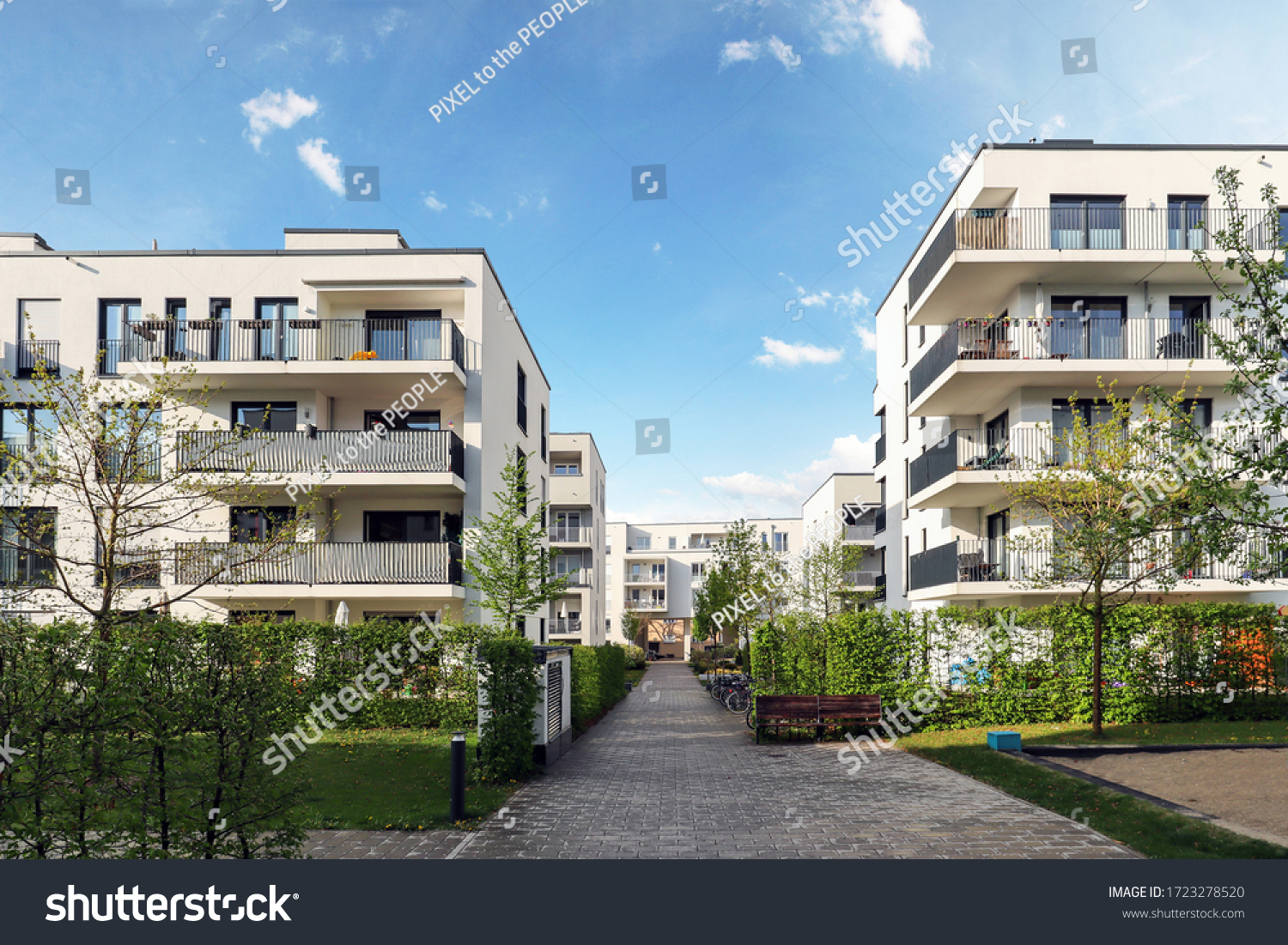 Cityscape of a residential area with modern apartment buildings, new green urban landscape in the city #1723278520