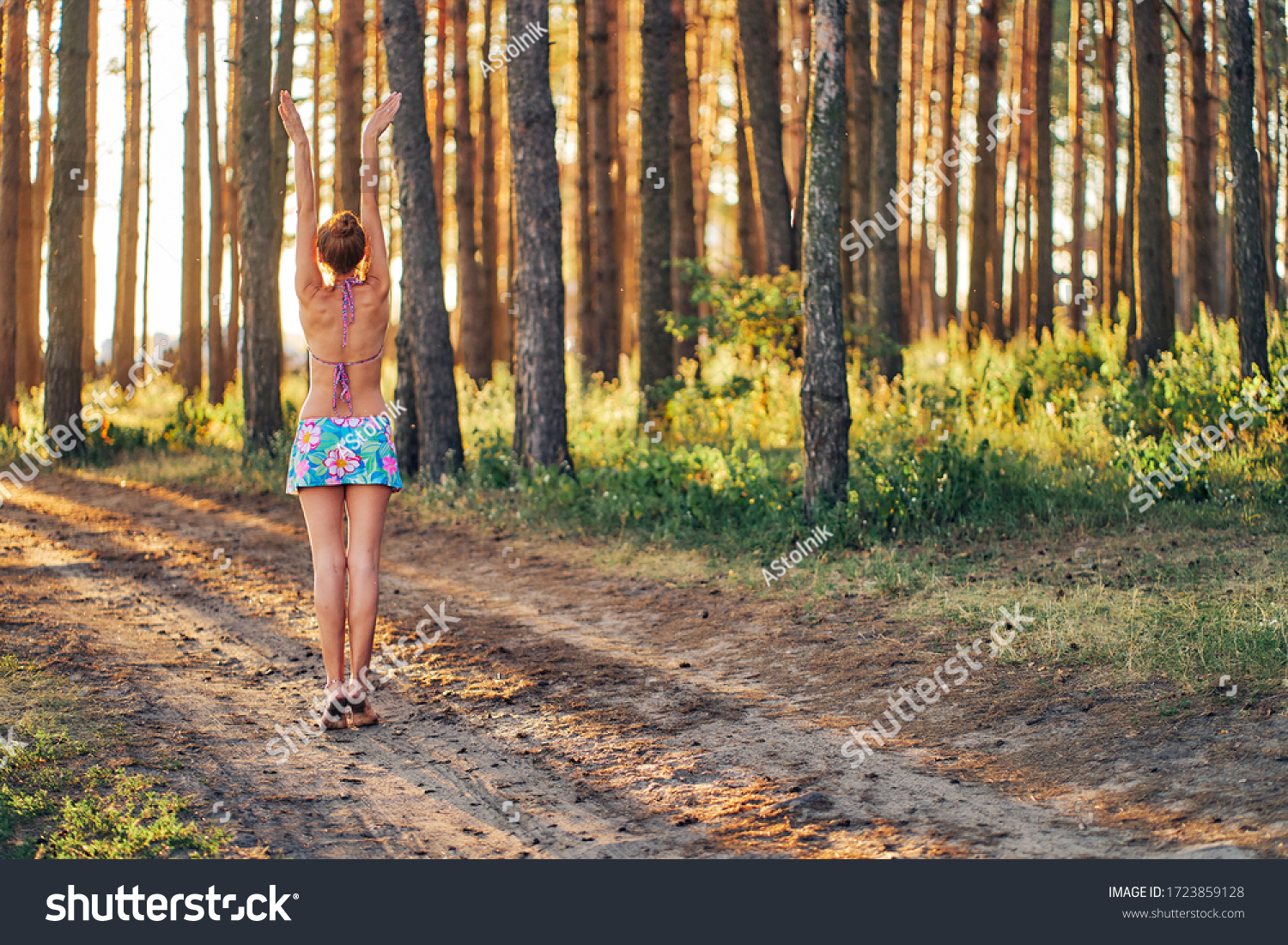 https://image.shutterstock.com/z/stock-photo-woman-in-swimsuit-and-sport-skirt-pulls-hands-to-the-sun-1723859128.jpg