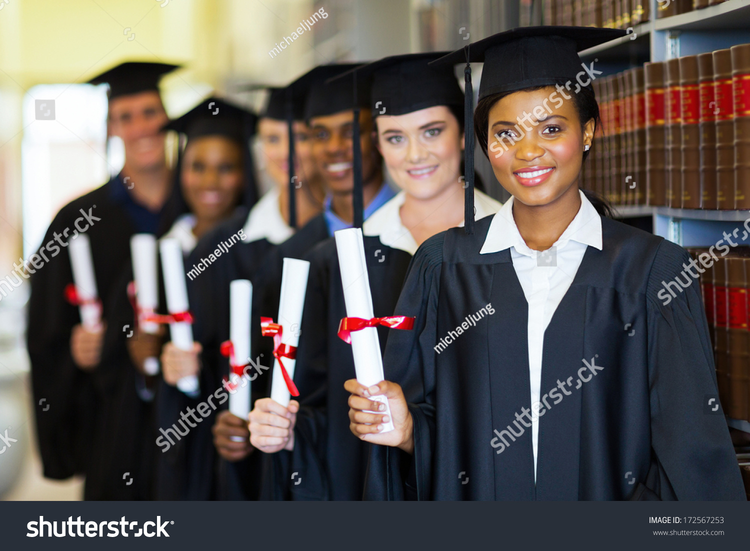 group happy graduates holding diploma library stock photo  group of happy graduates holding diploma in library