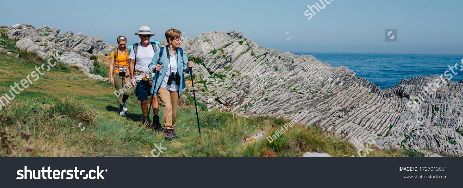Group of three people practicing trekking outdoors #1727013961