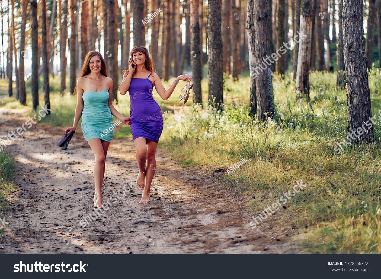 https://image.shutterstock.com/z/stock-photo-two-girls-in-blue-and-light-blue-short-dresses-dance-barefoot-on-nature-1728266722.jpg