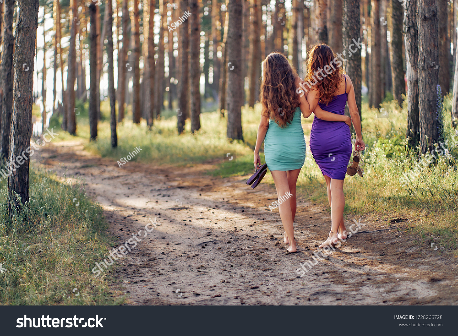 https://image.shutterstock.com/z/stock-photo-two-girls-leave-us-they-walk-barefoot-in-a-hug-along-a-forest-path-1728266728.jpg