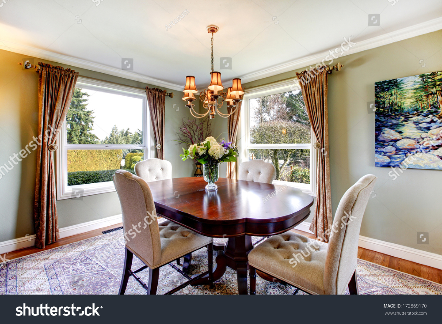 Olive tones dining room oldfashioned dining stock photo for Old fashioned dining room tables