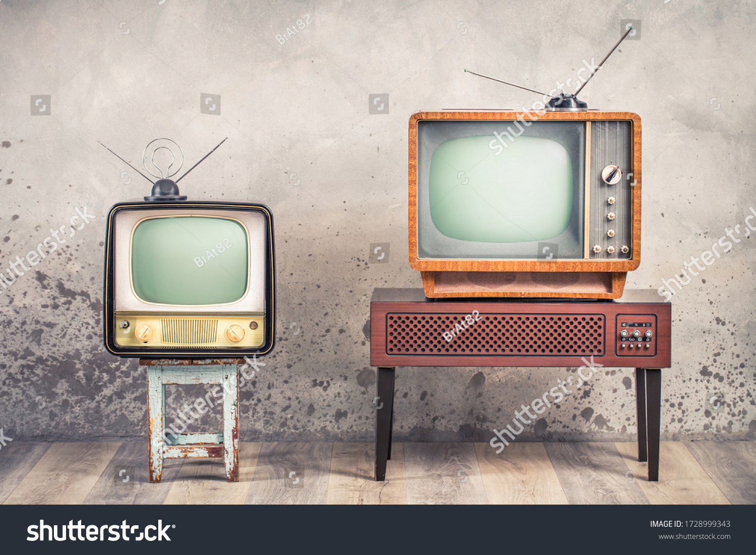 Two old retro classic analog CRT TV set receivers and aged wooden television stand with outdated amplifier front aged concrete wall background. Broadcasting, news concept. Vintage style filtered photo #1728999343