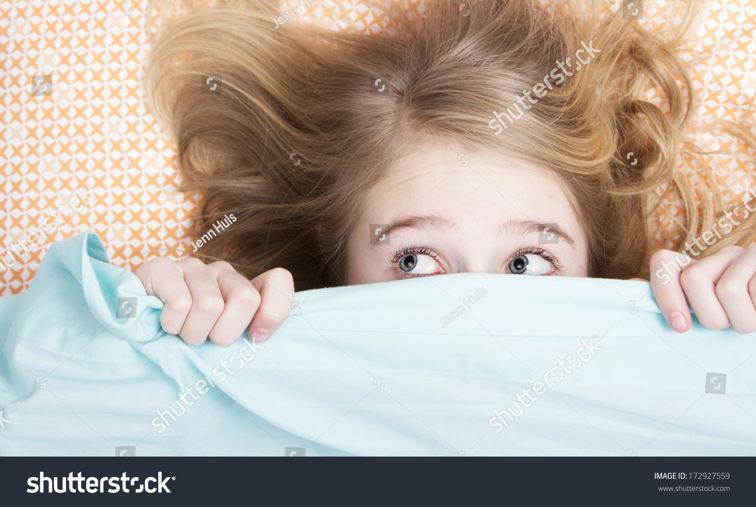 Child or teen hiding under covers in bed #172927559
