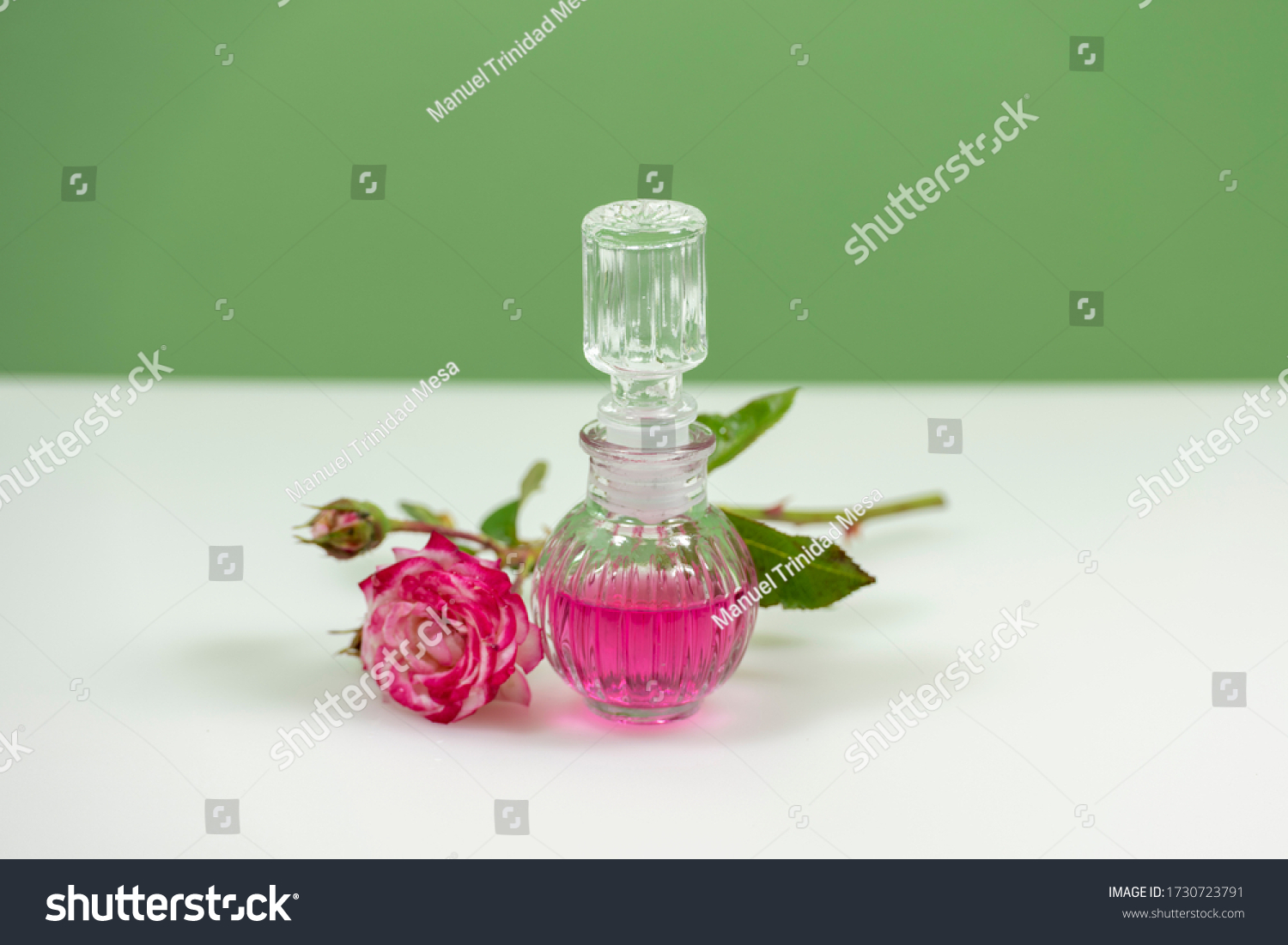 stock-photo-glass-bottle-with-perfume-es
