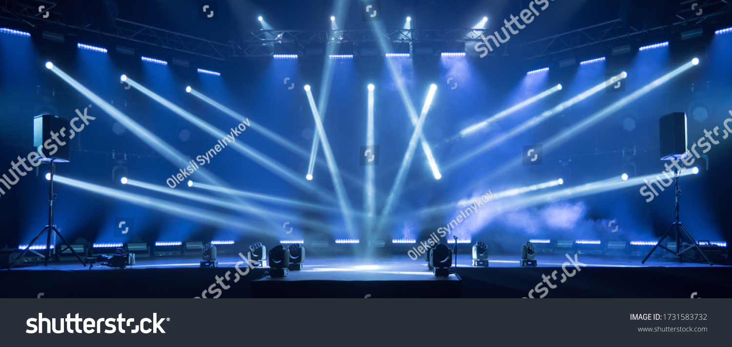 Online event entertainment concept. Background for online concert. Blue stage spotlights. Empty stage with blue spotlights. Blue stage lights. Online COVID-19 concert. Live streaming concert #1731583732