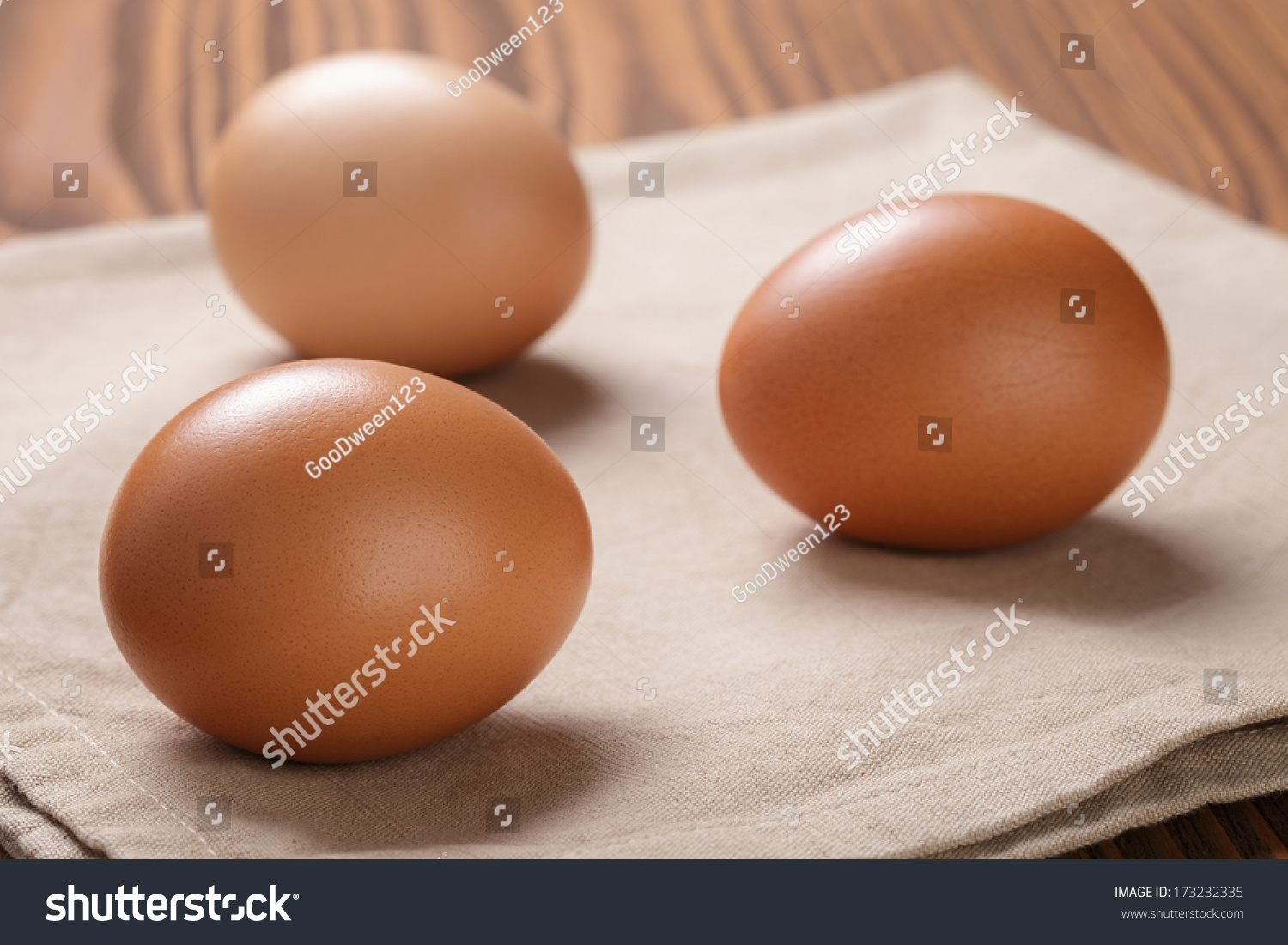 brown eggs  on napkin over table, selective focus #173232335