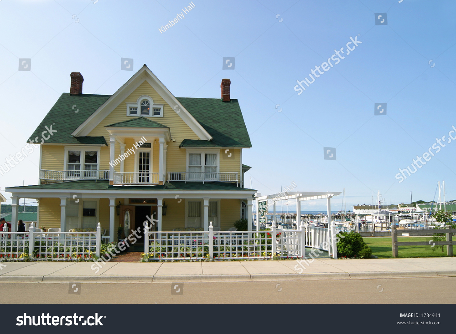 Yellow victorianstyle house green roof blue stock photo - Yellow house with green roof ...
