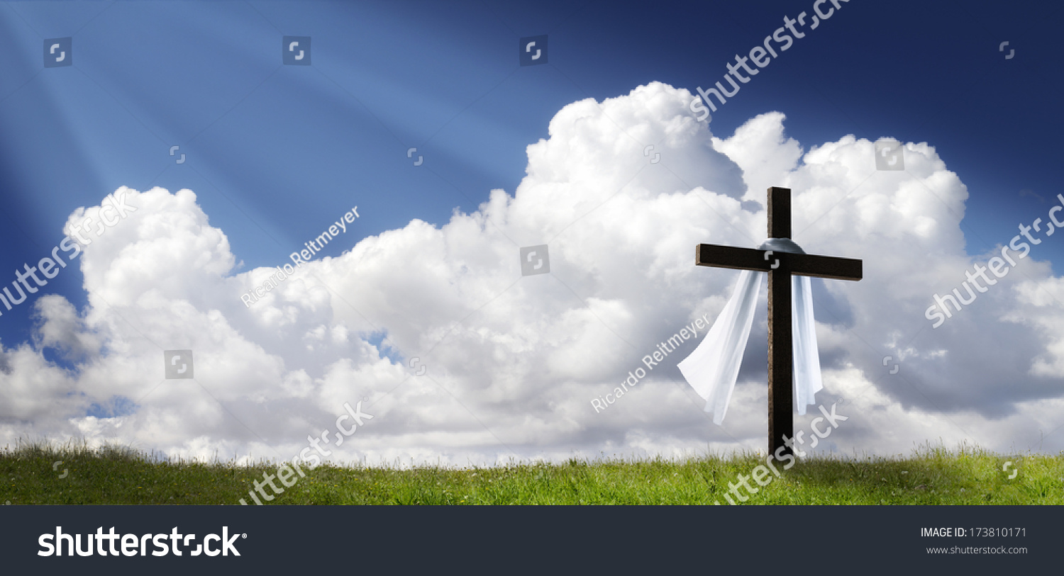 Silhouette of the holy cross on background of storm clouds stock - This Dramatic Easter Morning Sunrise Panorama With Blue Sky Bright Clouds Sunbeams And