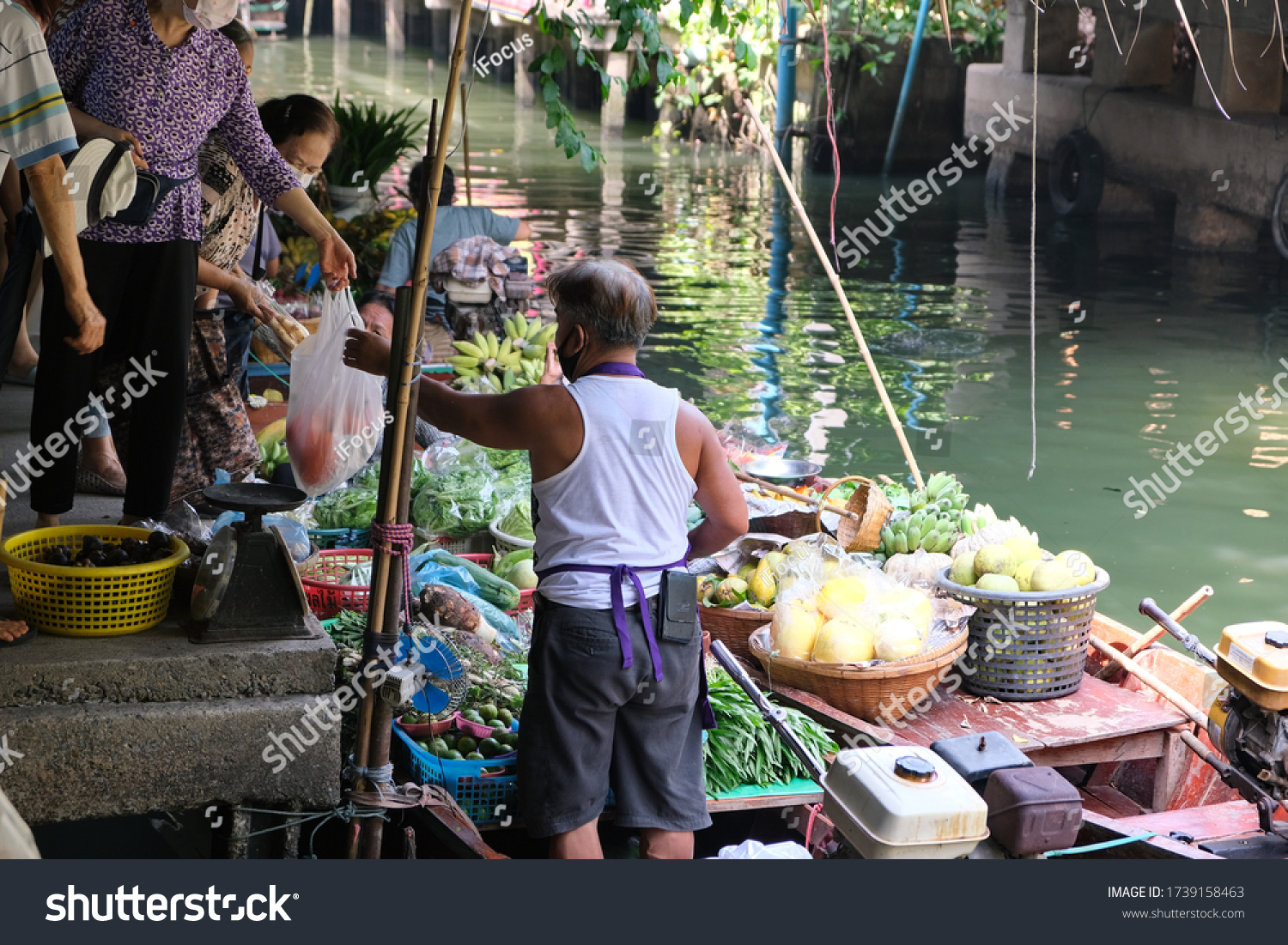 BANGKOK, THAILAND - MAY 23, 2020: People trade at Lat Mayom floating market on May 23, 2020 in Taling Chan district of Thai capital Bangkok