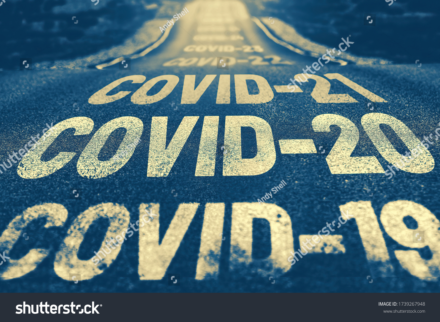 Deserted highway with the text COVID-19, COVID-20, COVID-21 and so on. The concept of new world pandemics. Blue background #1739267948