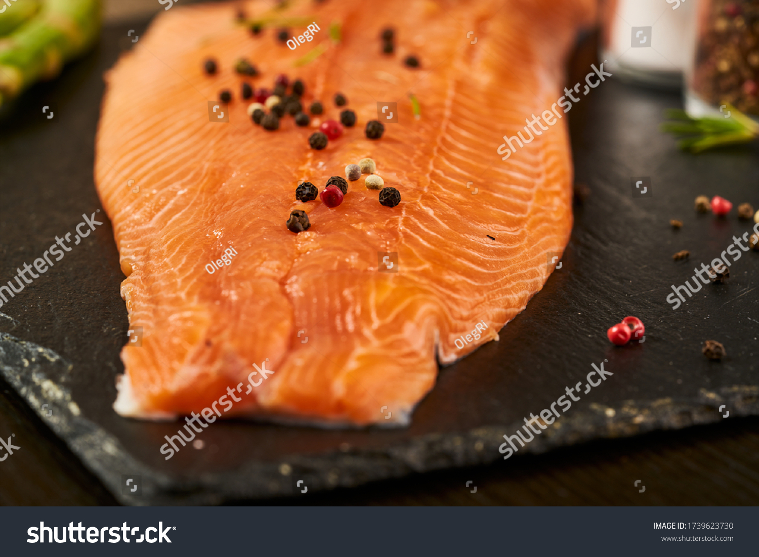 Salmon with black pepper on plate close up. #1739623730