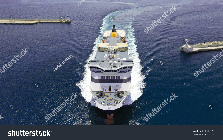 Aerial drone photo of passenger ferry reaching destination - busy port of Piraeus, Attica, Greece #1740809909