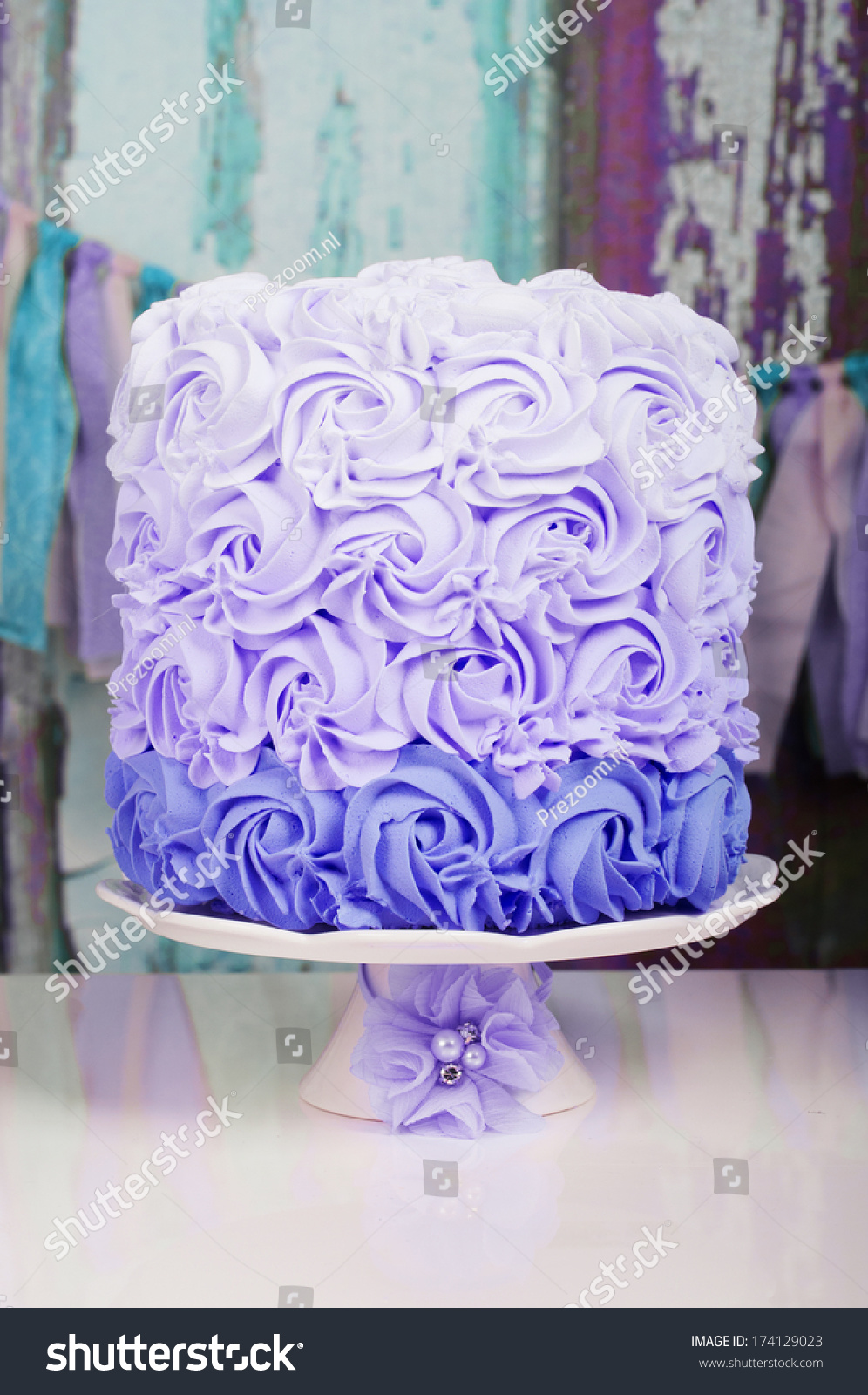 Purple Wedding Cake On A Stand With Flower Decoration