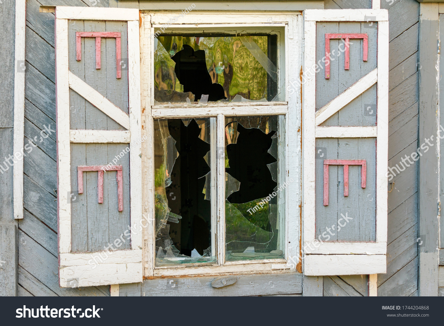 stock-photo-broken-window-of-an-old-wood