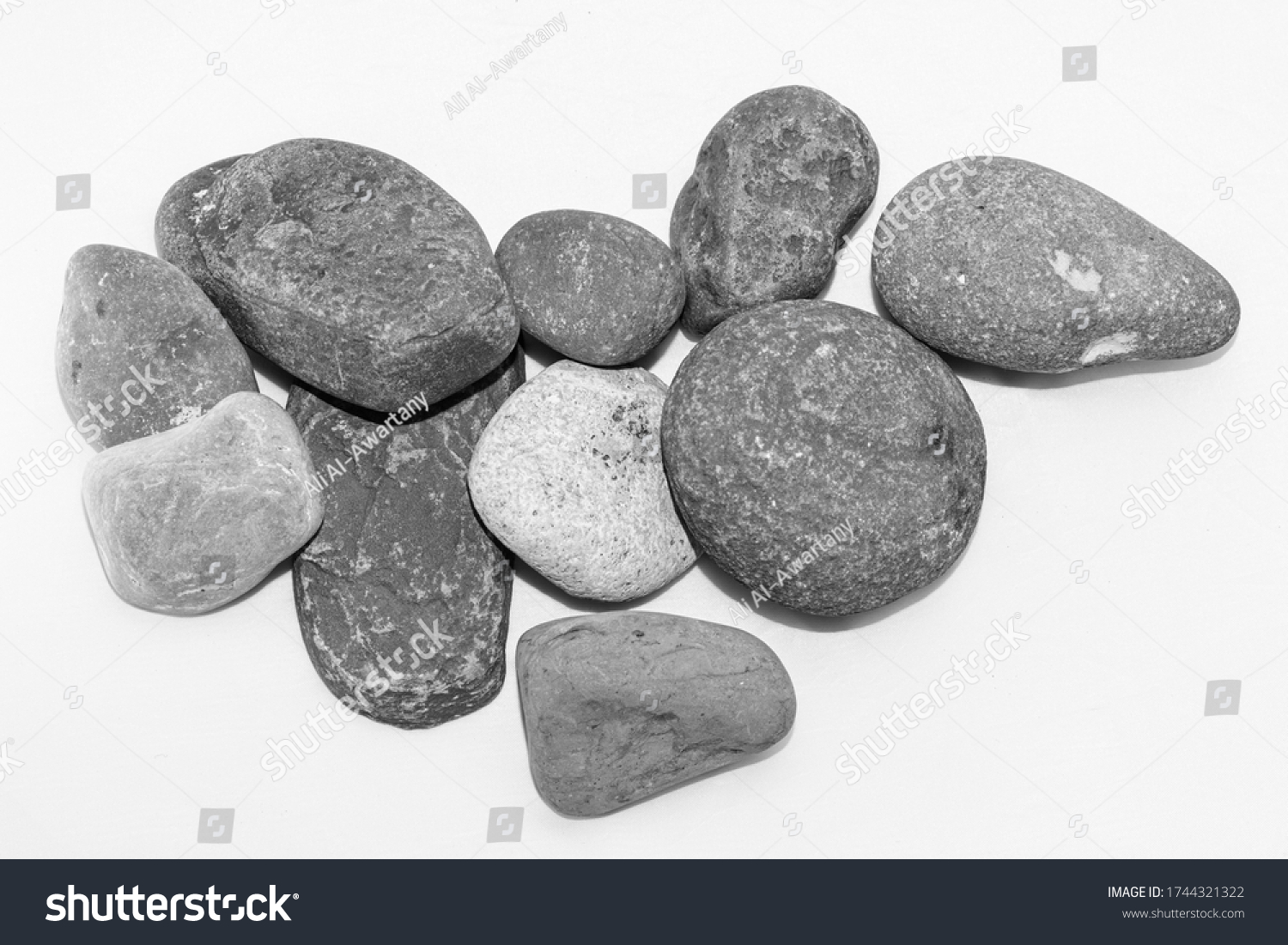 stock-photo-scattered-sea-pebbles-smooth