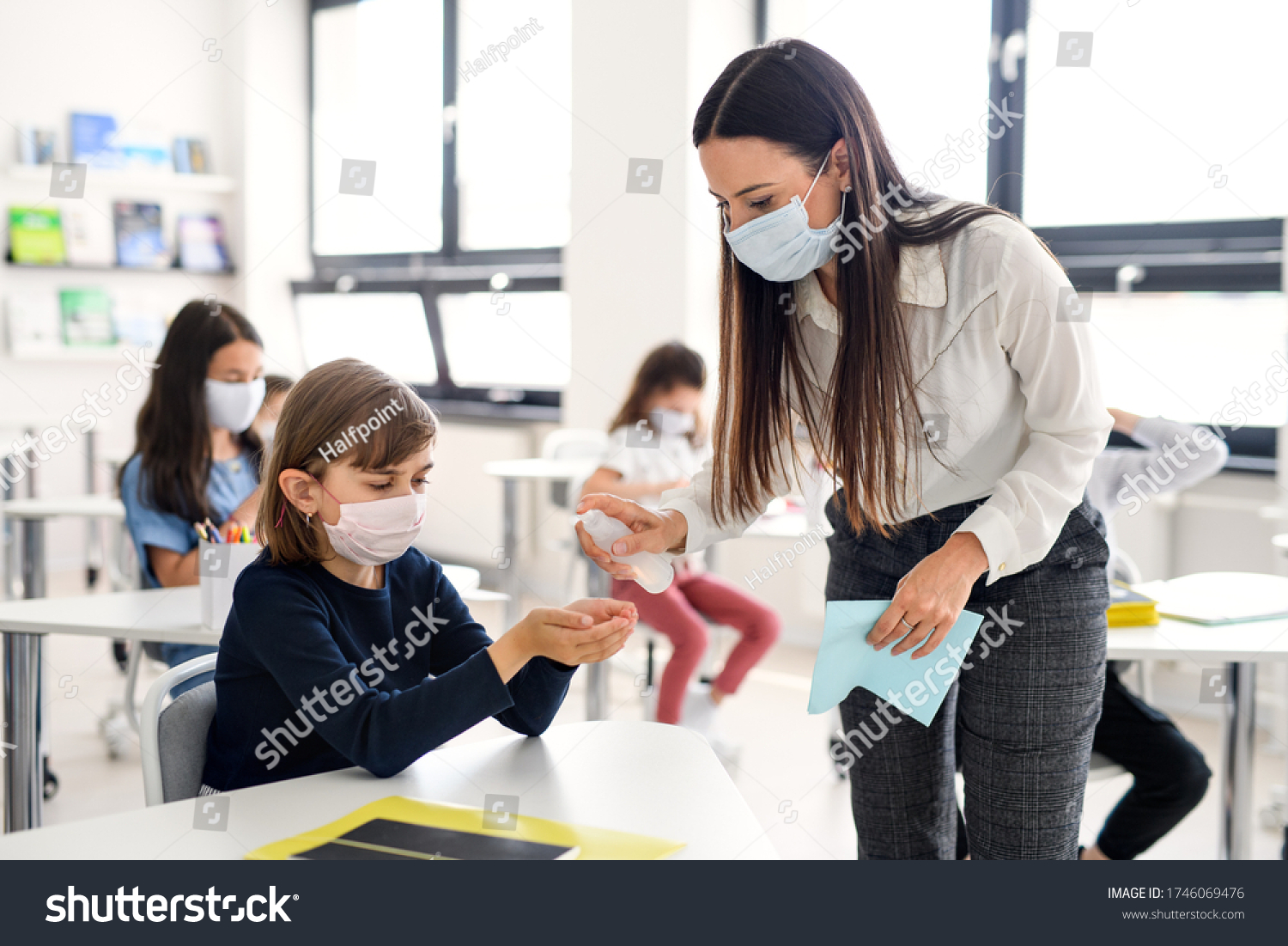 Teacher, children with face mask at school after covid-19 quarantine and lockdown. #1746069476