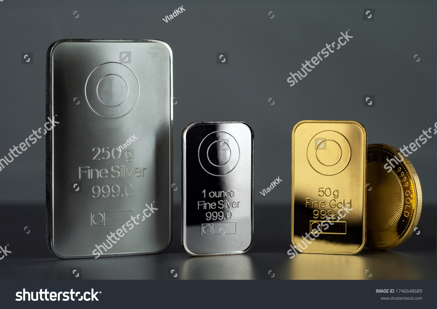 Silver and gold bars and coin on a dark background. #1746648689