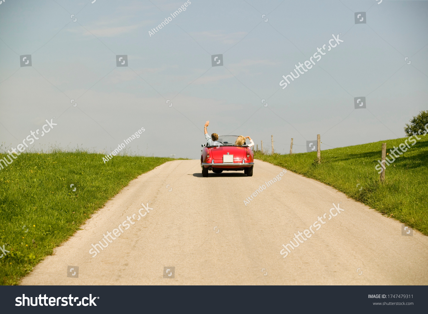 Couple driving convertible in countryside #1747479311