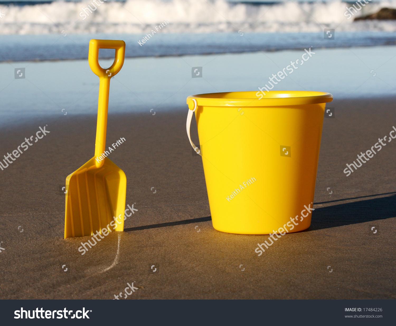 yellow childs plastic bucket spade on stock photo 17484226
