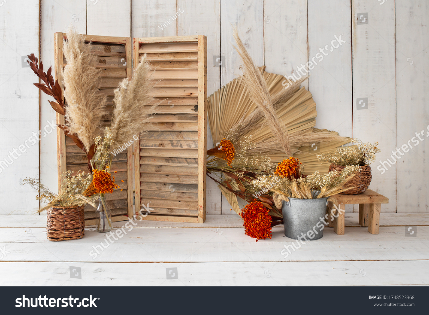 Rustic backdrop made with dried leaves and red little flowers. #1748523368