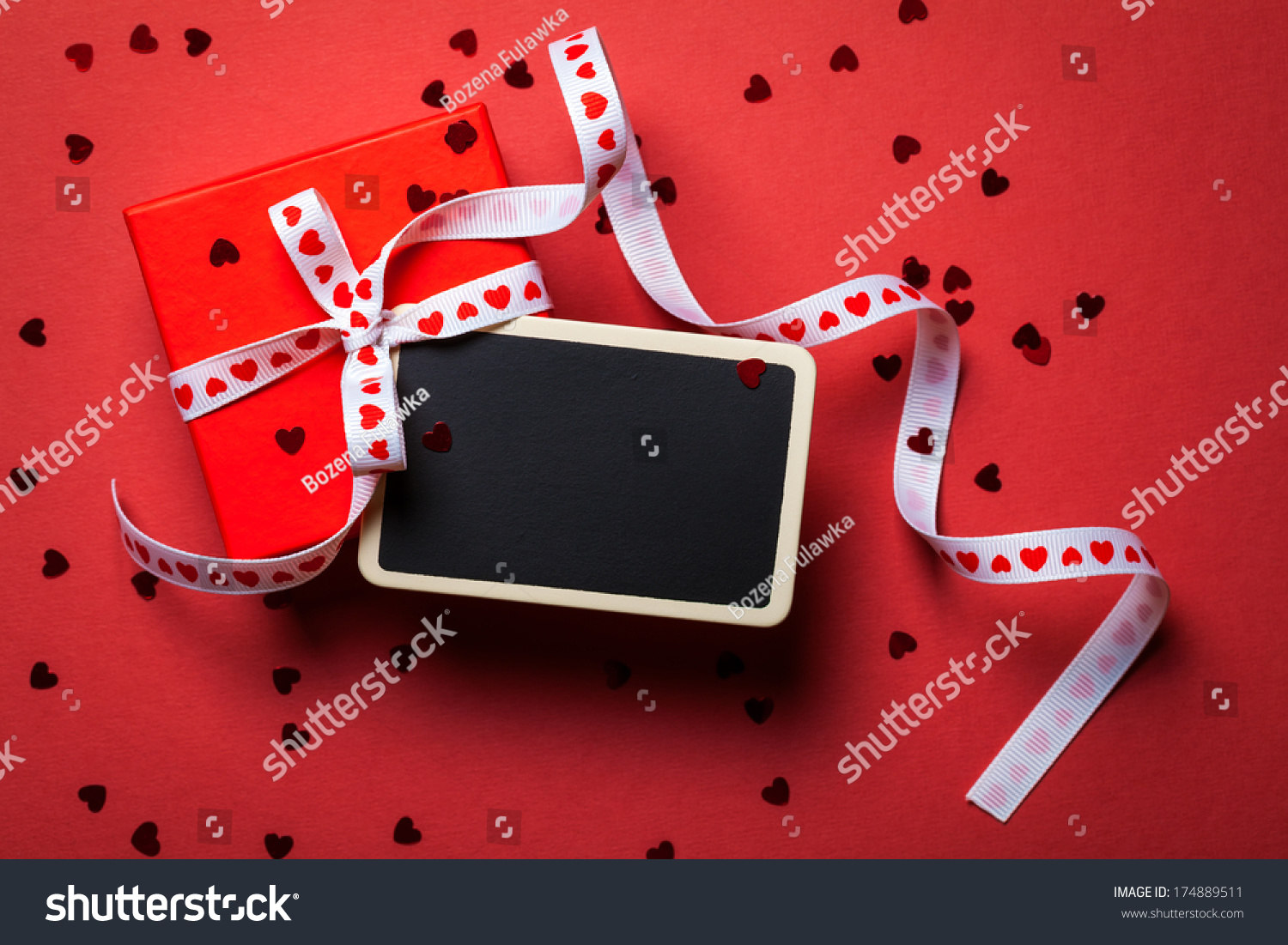 Gift box framed blackboard on red stock photo 174889511 shutterstock gift box with framed blackboard on red paper background valentines day top view negle Choice Image