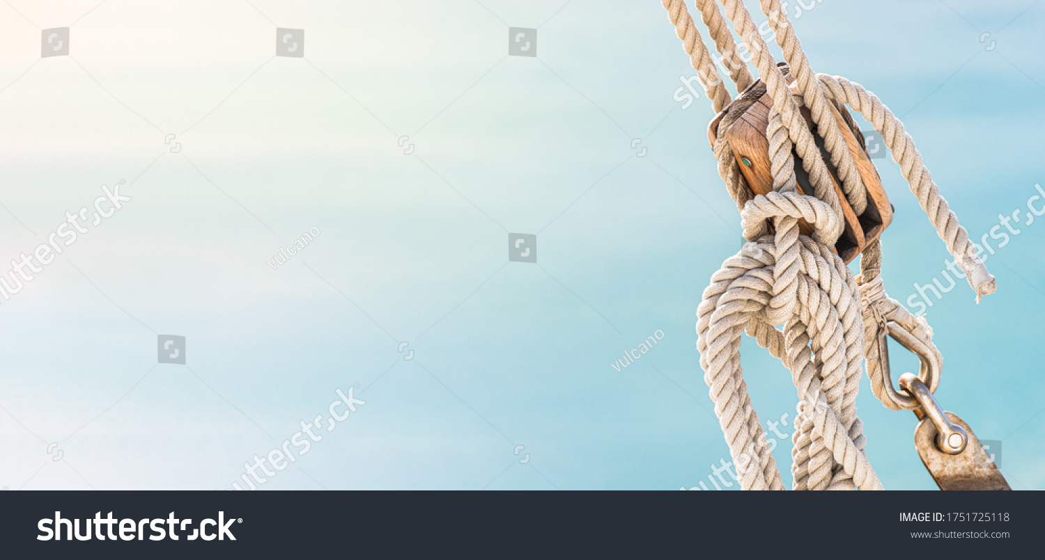 Sailing boat pulley, block and tackle with moored nautical rope. Panoramic water nautic background with copy space.  #1751725118