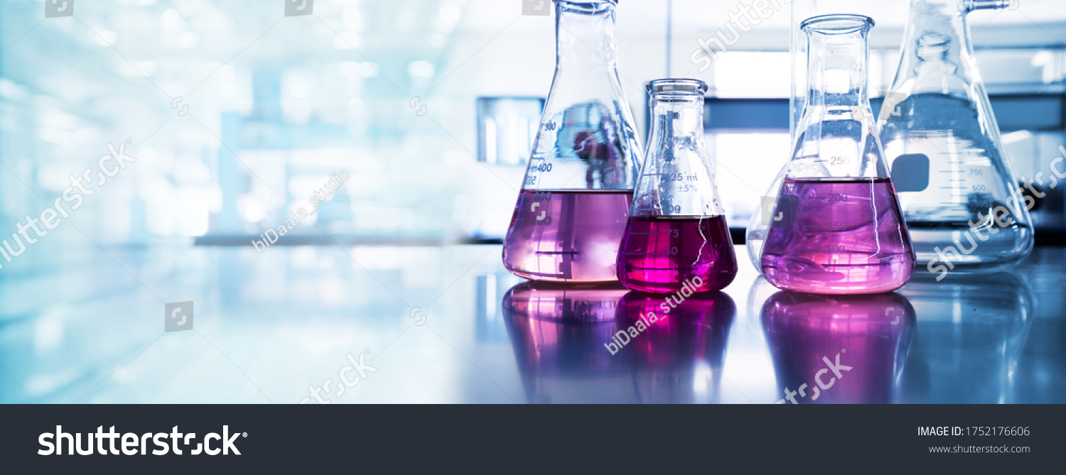 purple glass flask in blue research chemistry science banner laboratory background  #1752176606