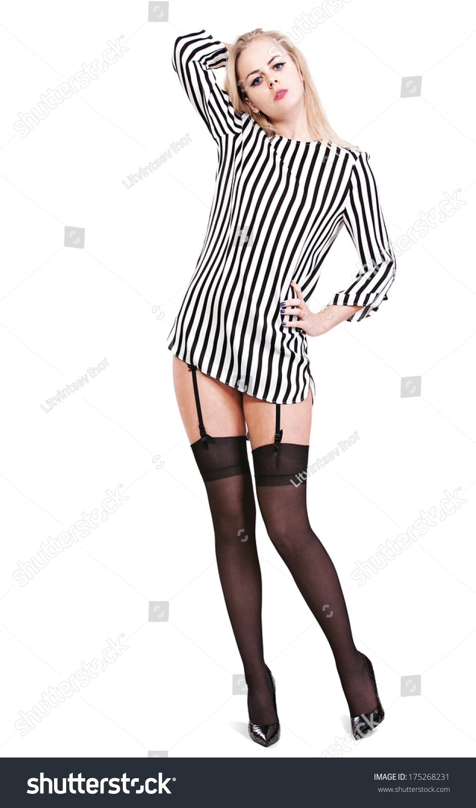 Young Girl In A Striped Blouse And Black Stockings On An Isolated White Background In Full