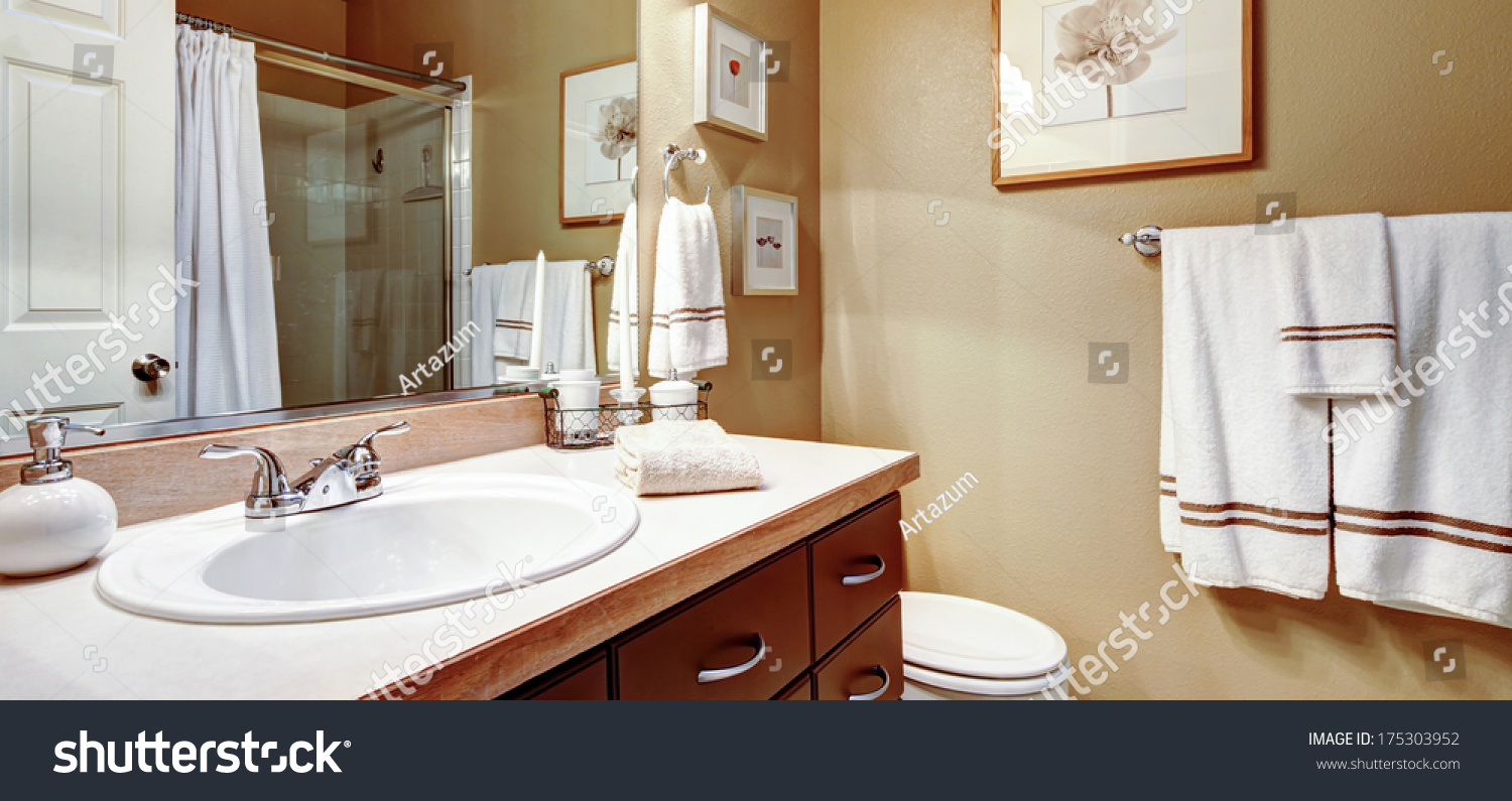 Warm colors bathroom decorated white towels stock photo for Warm bathroom
