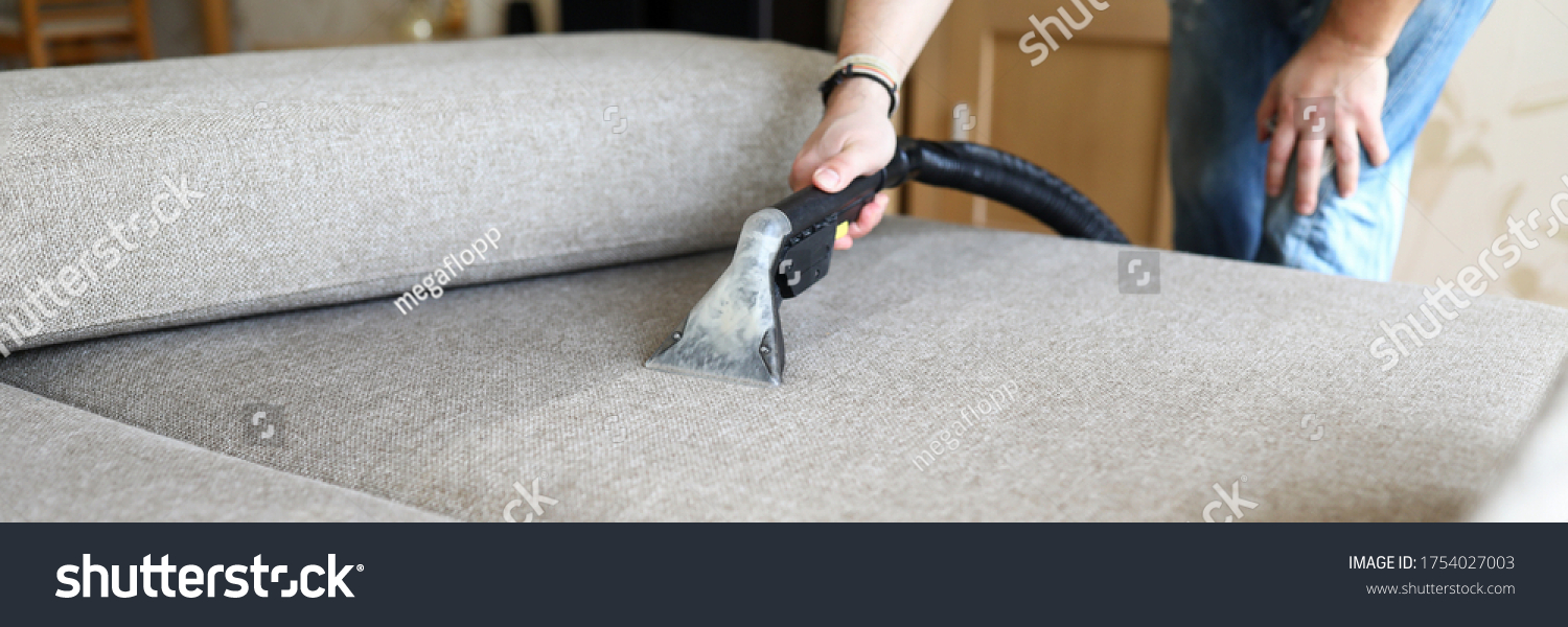 Close-up of hoover for furniture and dirty sofa. Hoovering and cleaning house, housekeeper or special service for house cleanliness maintenance. Washing fabric cloth #1754027003