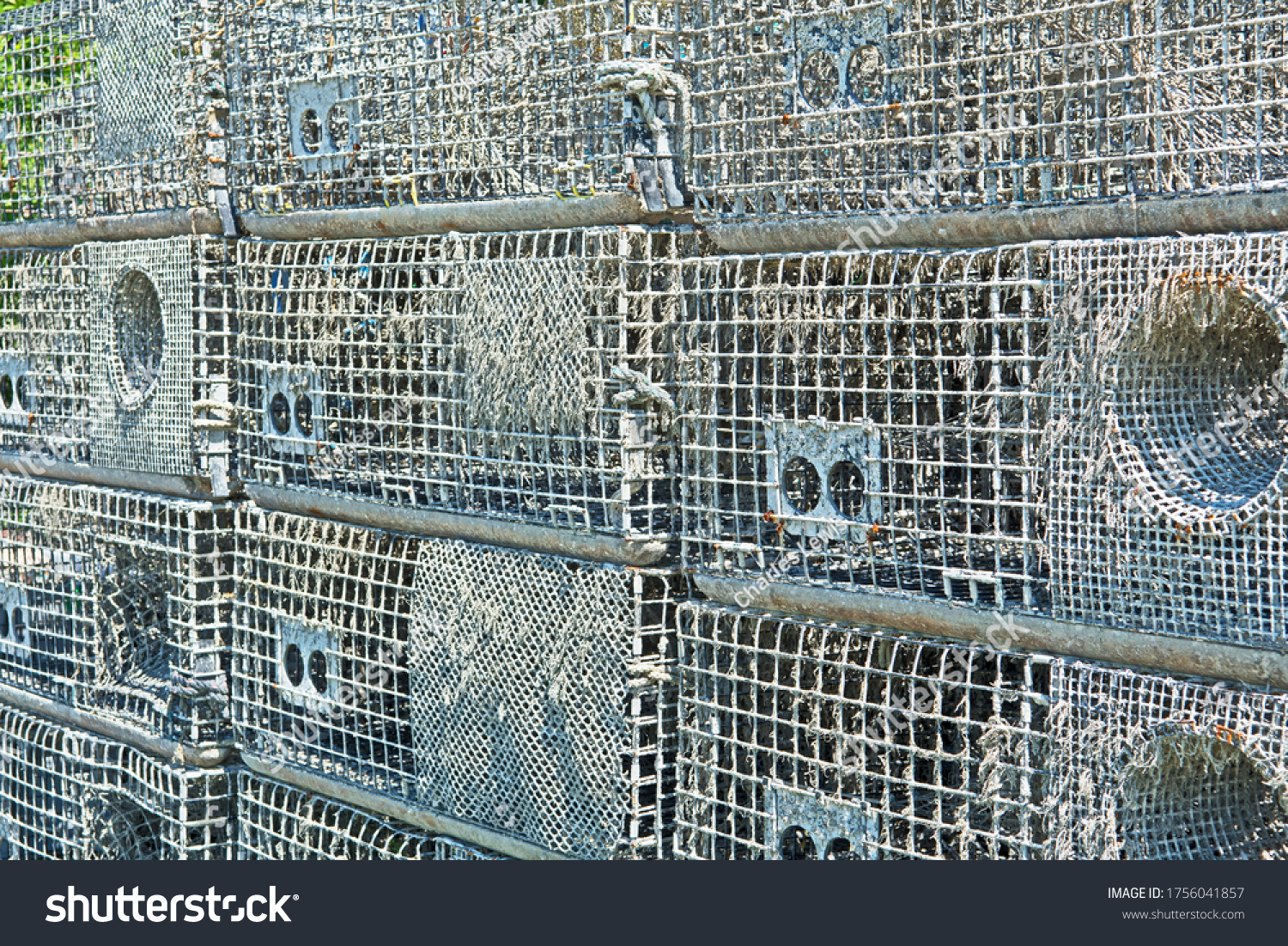 A stack of lobster traps, also known as lobster pots, near a fishing port in Massachusetts