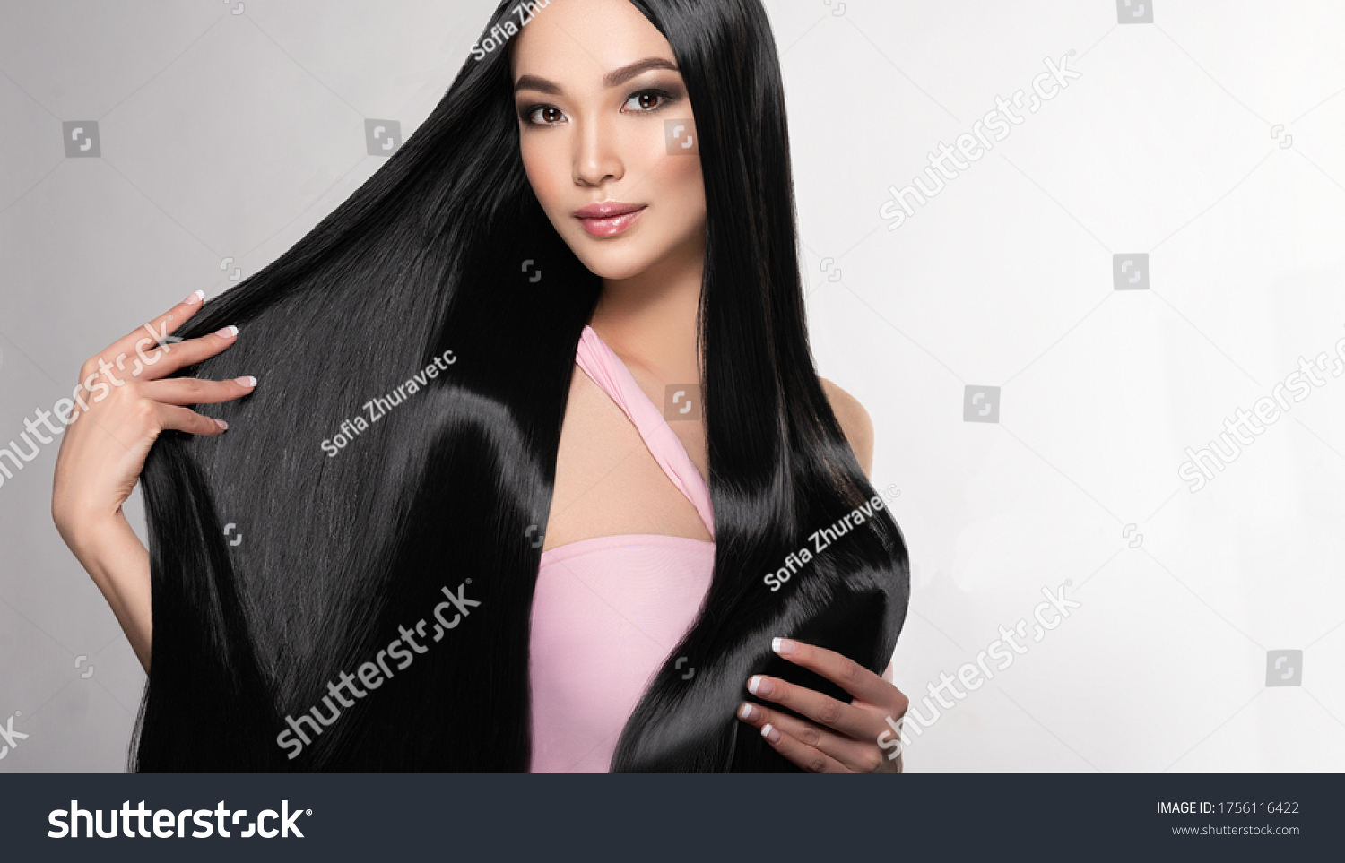 Beautiful asian model girl with shiny black and straight long hair . Keratin straightening . Treatment, care and spa procedures for hair . Chinese girl with smooth hairstyle #1756116422