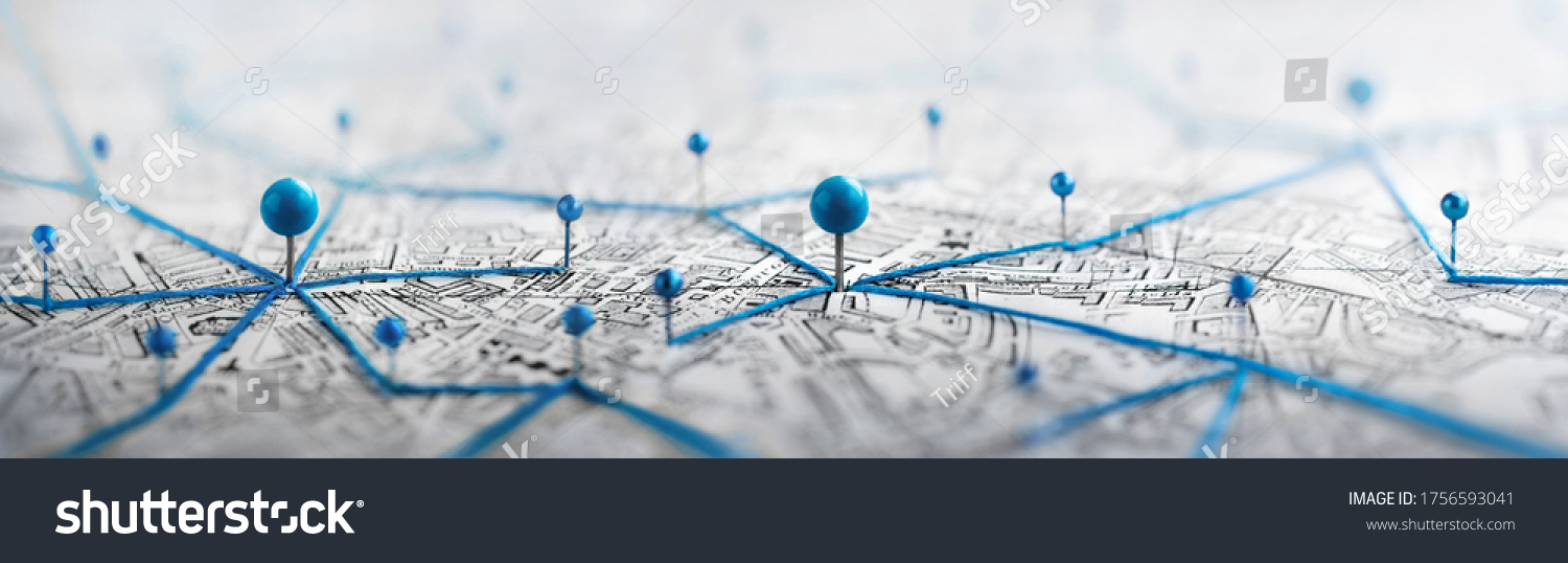 Location marking with a pin on a map with routes. Find your way. Adventure, discovery, navigation, communication, logistics, geography, transport and travel theme concept background. #1756593041