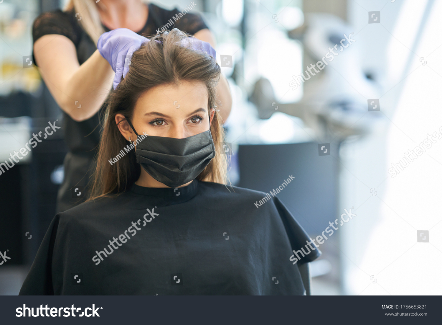 Adult woman at hairdresser wearing protective mask due to coronavirus pandemic #1756653821