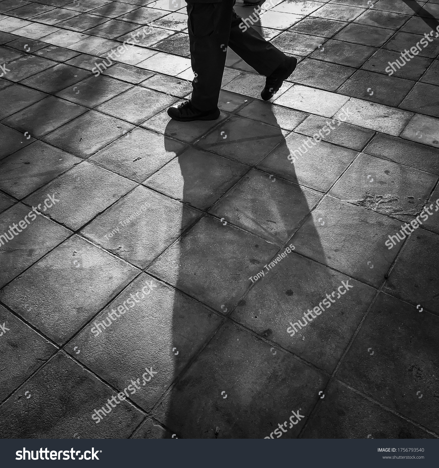 The light and shadow of a person walking.