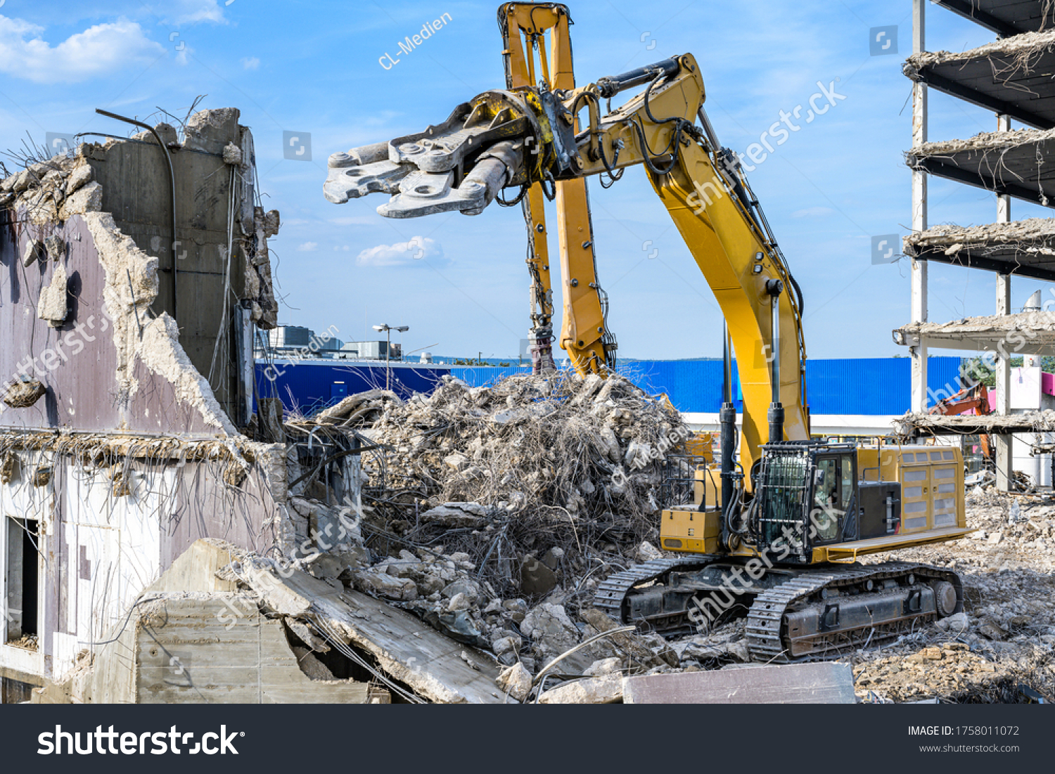 Building House destruction Demolition site Excavator with hydraulic crusher machine ruin house #1758011072