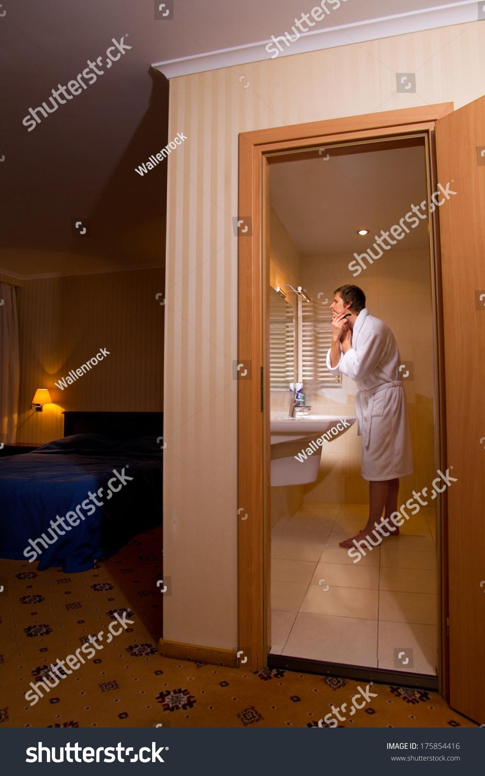 man shaving bathroom going out stock photo 175854416 - shutterstock