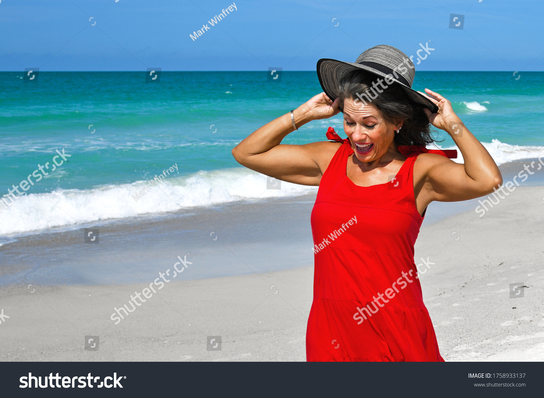 stock-photo-beautiful-woman-in-red-summe