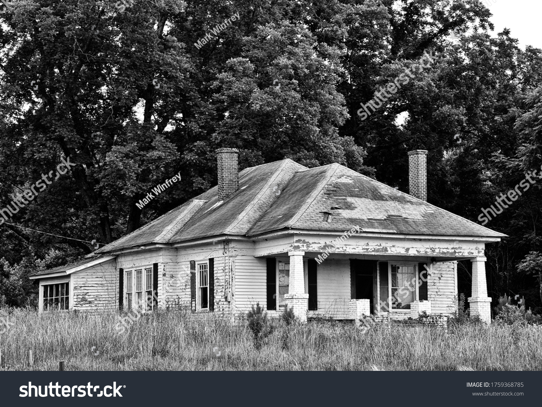 stock-photo-an-abandoned-run-down-farmho