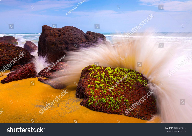 Splashes of waves on coastal rocks. Breaking waves rocks. Waves crashing on rocks #1760368745
