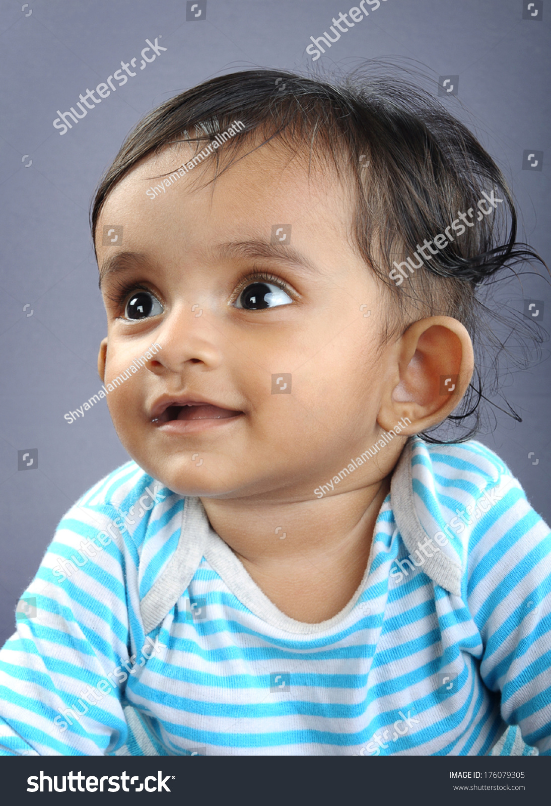 indian cute baby looking stock photo (royalty free) 176079305