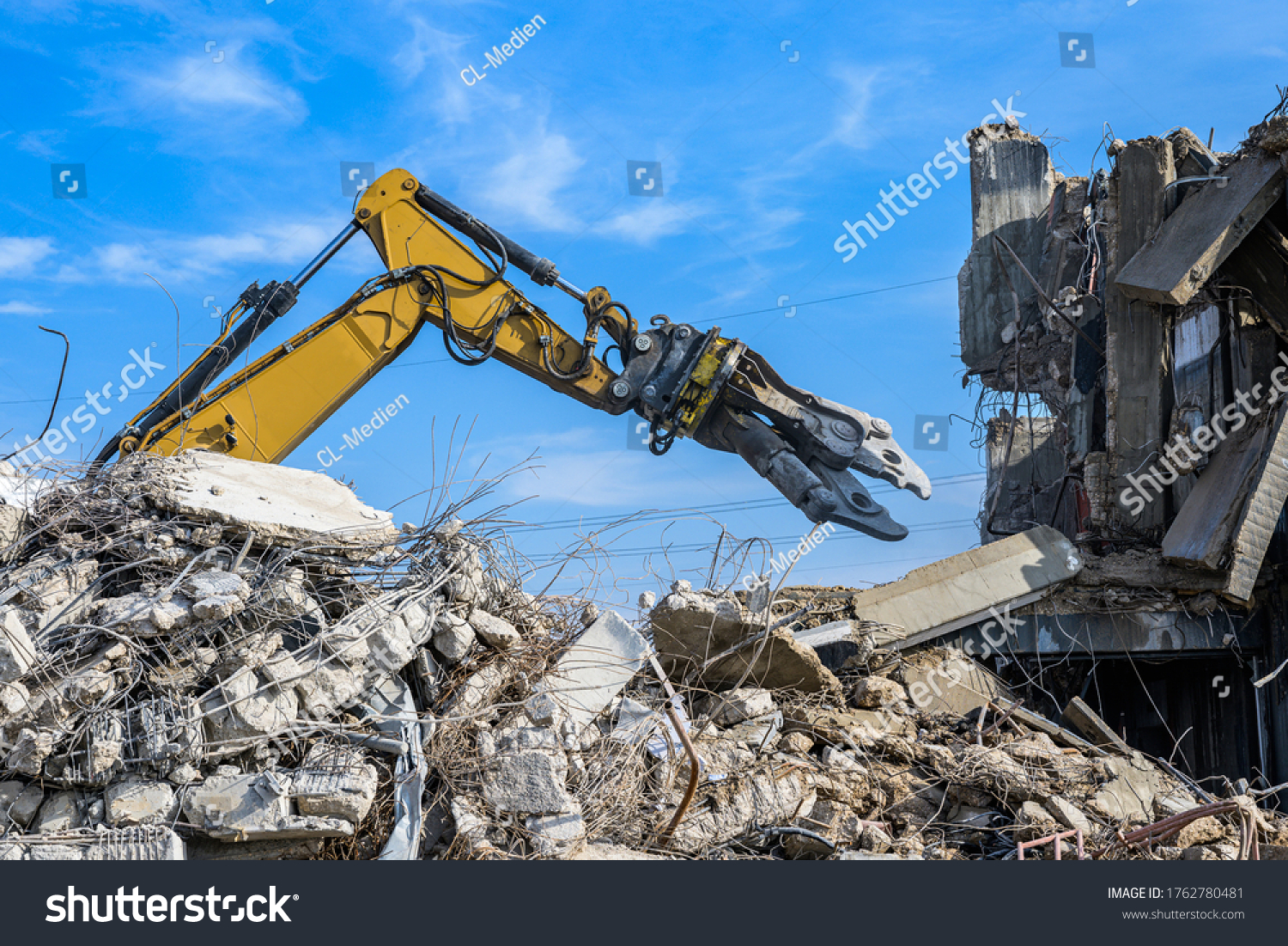 Building House Demolition site Excavator with hydraulic crasher machine and yellow container #1762780481