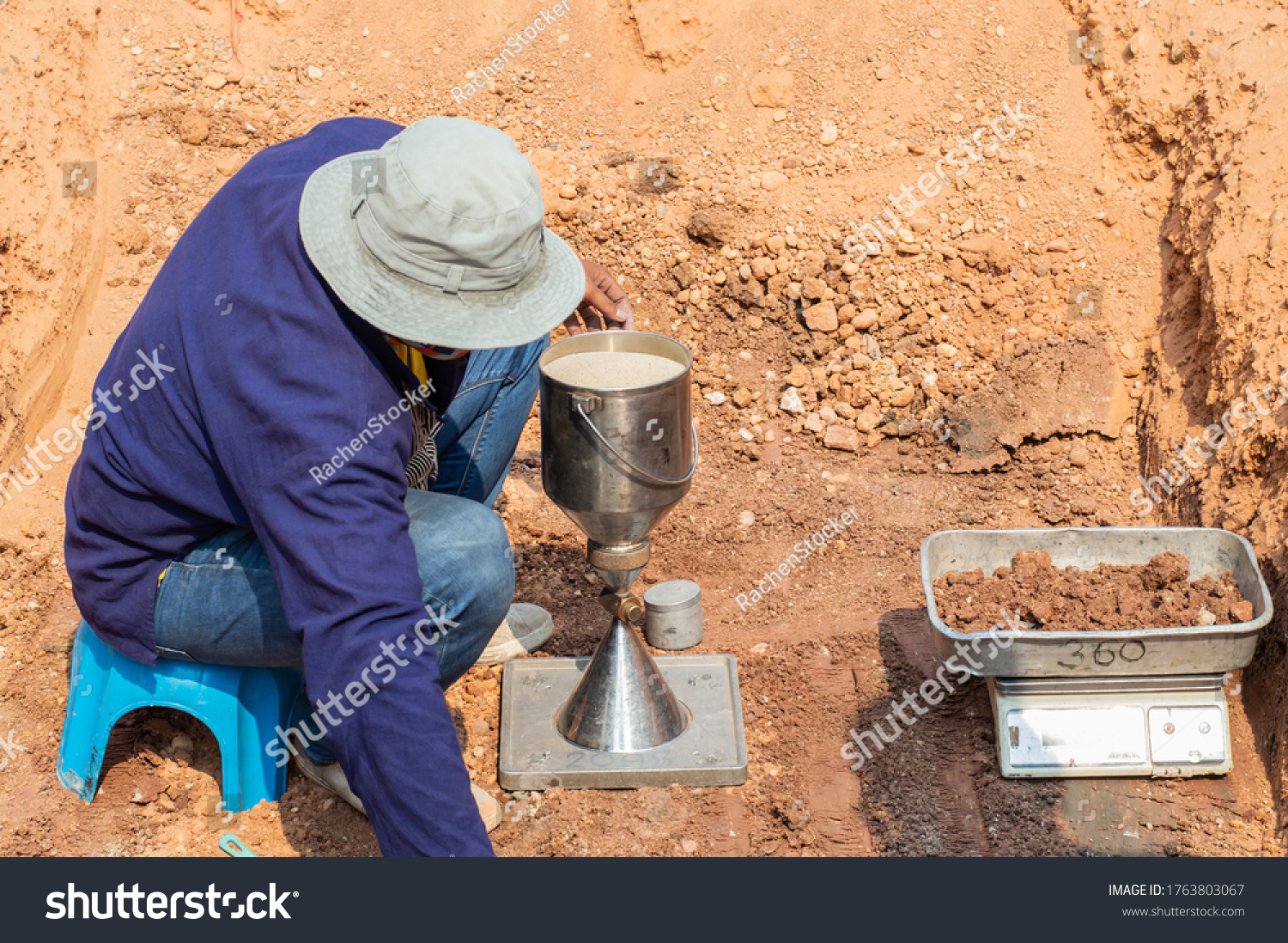 Worker using equipment for testing laboratory field density test sand cone method and soil density test of road under the construction.Soil field density test sand cone method calculation . #1763803067