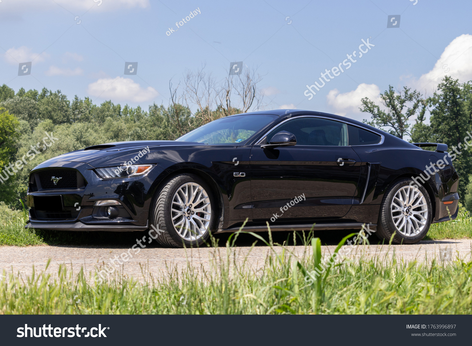 stock-photo-black-ford-mustang-gt-car-on