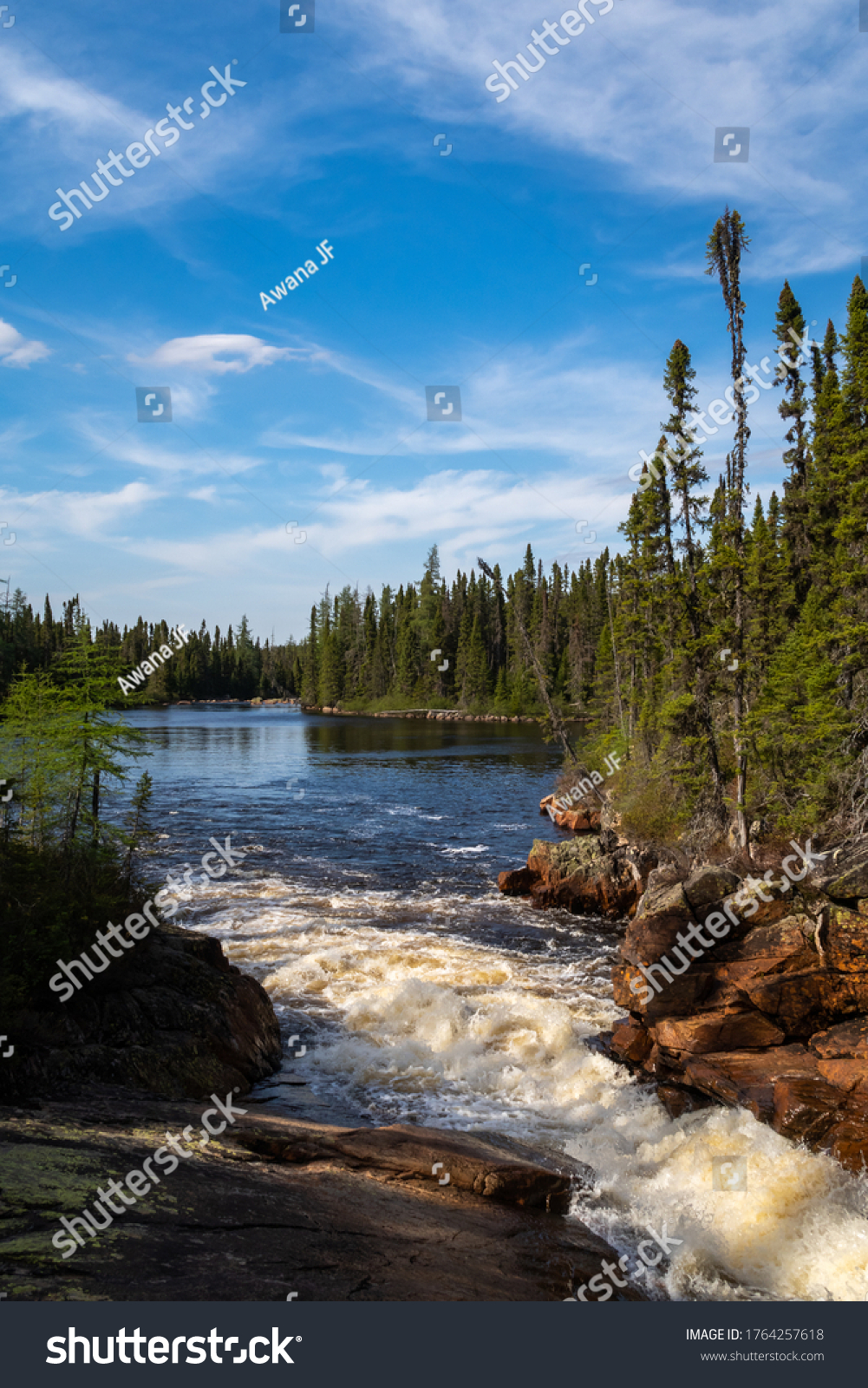 Beautiful view of a river and boreal forest in Charlevoix, Quebec