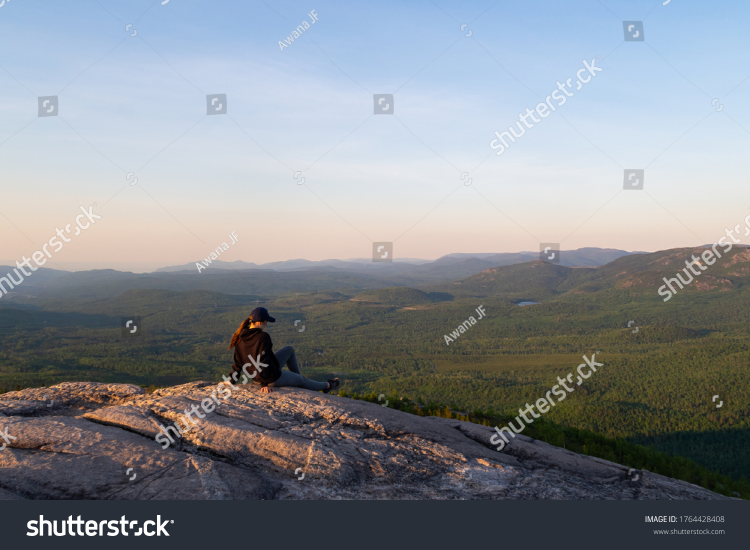 stock-photo-young-woman-sitting-at-the-s