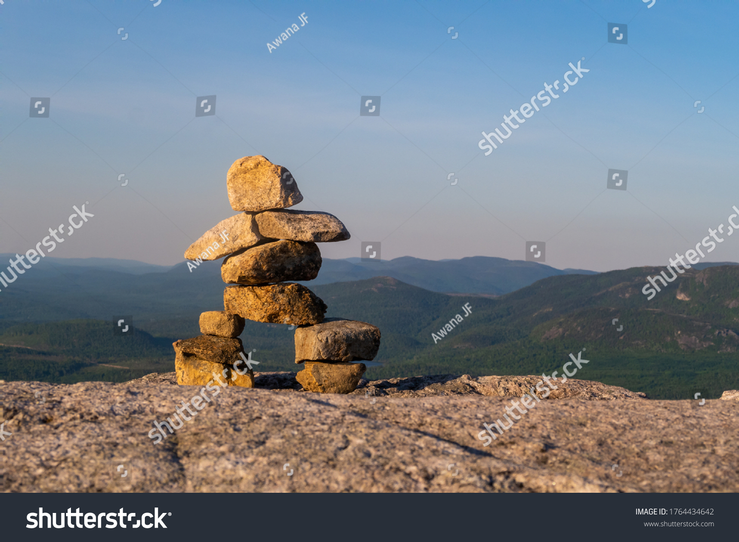 "View of an Inukshuk at the summit of ""La Chouenne"" mountain in Charlevoix, Quebec"